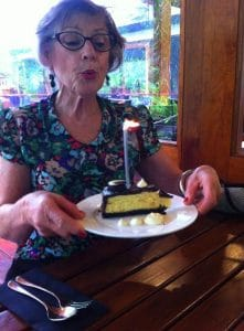 Jane blowing out a candle on her birthday cake